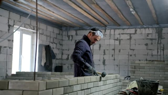 construction of a brick wall. - ukrainian ethnicity stock videos and b-roll footage