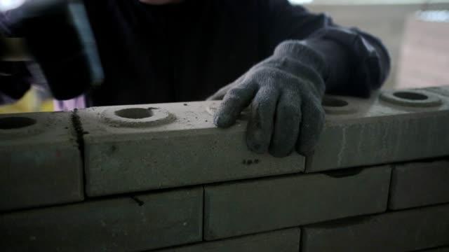 Construction of a brick wall.