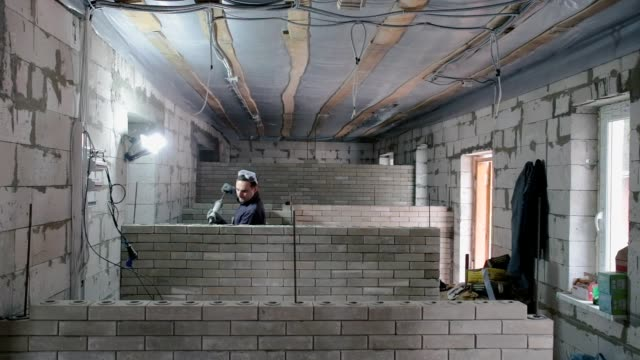 construction of a brick wall. - wall building feature stock videos & royalty-free footage