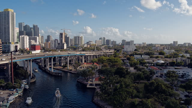 construction of a new drawbridge on miami river between downtown miami and the residential east little havana neighborhood. aerial footage with the cinematic forward and ascending camera motion. - bascule bridge stock videos & royalty-free footage