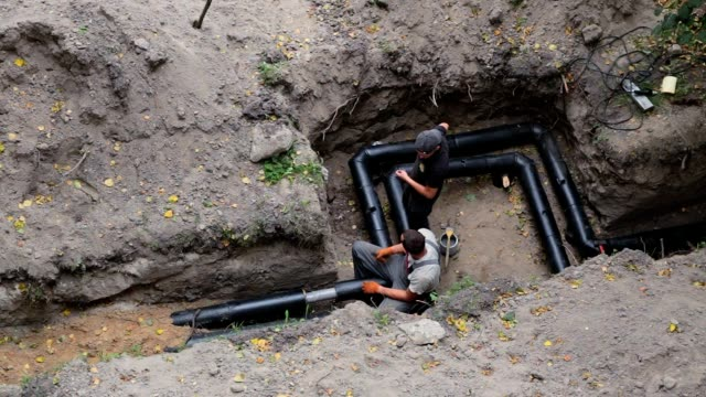 construction of a pipeline for water supply at home. - installing stock videos and b-roll footage