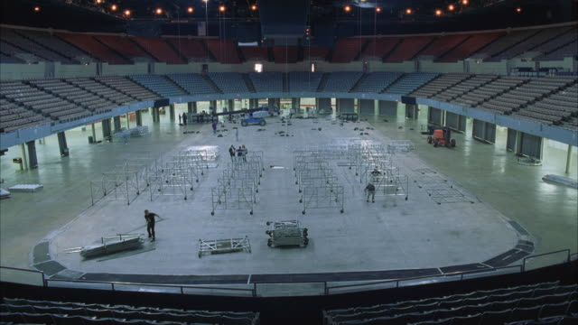 t/l ws ha construction of large rock concert stage in stadium - installing stock videos & royalty-free footage