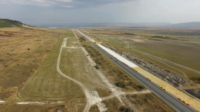 aerial: construction of modern highways - road construction stock videos and b-roll footage
