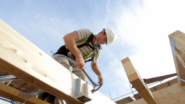 construction of new build houses - timber stock videos & royalty-free footage