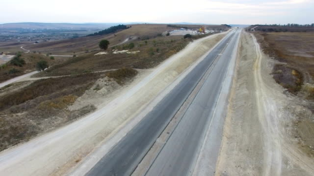 aerial: construction of new highways in countryside - bridge built structure stock videos & royalty-free footage