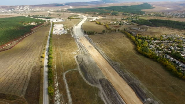 aerial: construction of new roads at start stage - road construction stock videos and b-roll footage