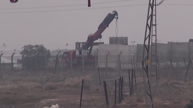 construction of security walls on turkish-syrian border continue in akcakale, turkey on january 12, 2017. purpose of the wall is preventing smuggling... - surrounding wall stock videos & royalty-free footage