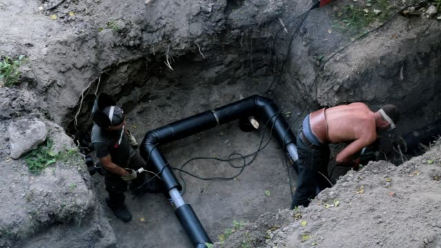 construction of the pipeline. - trench stock videos and b-roll footage