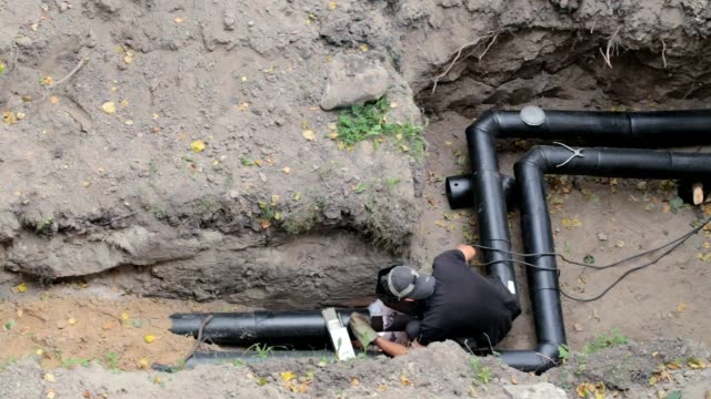 construction of the pipeline. - ukrainian ethnicity stock videos and b-roll footage