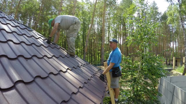 construction of the roof of a residential building. - repairman stock videos & royalty-free footage