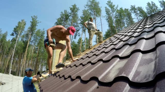 construction of the roof of a residential building. - tile stock videos & royalty-free footage