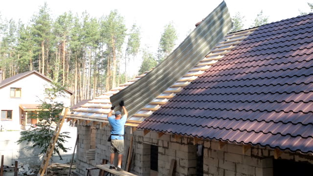 construction of the roof of a residential building. - construction material stock videos and b-roll footage