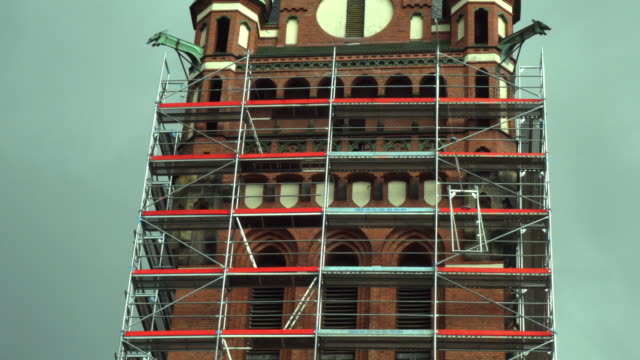construction of the scaffolding on the tower - scaffolding stock videos & royalty-free footage