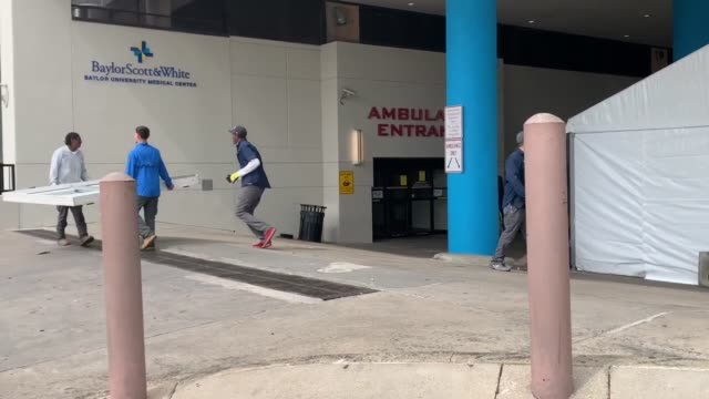 vídeos y material grabado en eventos de stock de construction of triage center and lockdown of hospital - edificio médico
