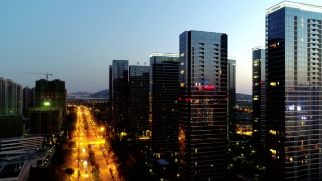 vidéos et rushes de construction of wuxi new town night view - aménagement de l'espace