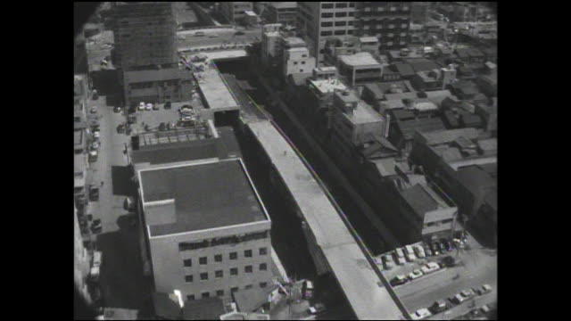 construction on the tokyo metropolitan expressway progresses near nihonbashi. - showa period stock videos & royalty-free footage