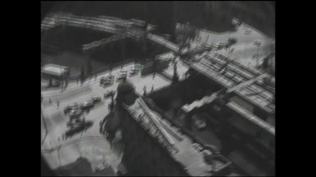 construction on the tokyo metropolitan expressway spans a city street in nihonbashi. - showa period stock videos & royalty-free footage
