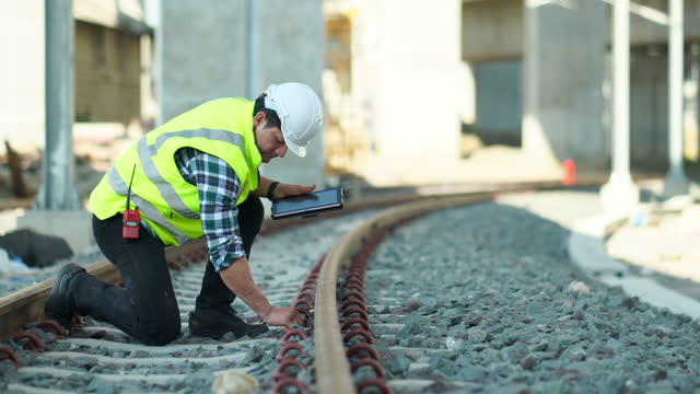 construction railway site man manager inspector checking. transporter and logistics industry, manager man in site transport industry. railway system inspector engineer, department of transportation, maintenance station business industry largest travel - rail transportation stock videos & royalty-free footage