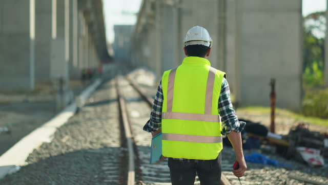construction railway site man manager inspector checking. transporter and logistics industry, manager man in site transport industry. railway system inspector engineer, department of transportation, maintenance station business industry largest travel - railway track点の映像素材/bロール