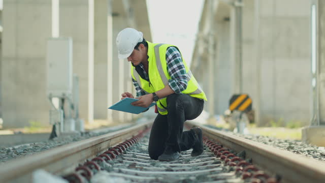 construction railway site man manager inspector checking. transporter and logistics industry, manager man in site transport industry. railway system inspector engineer, department of transportation, maintenance station business industry largest travel - railway track stock videos & royalty-free footage