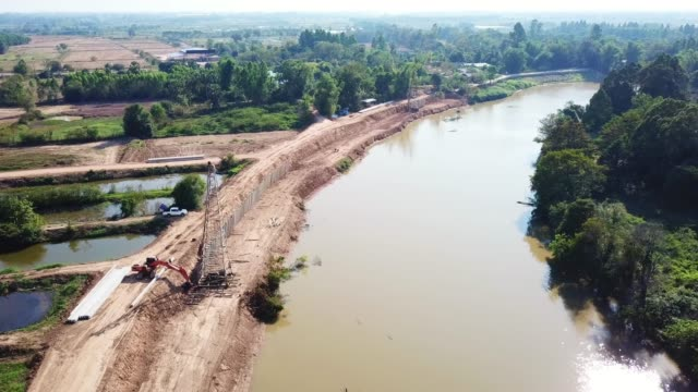 Construction road and dam protect water flood near river