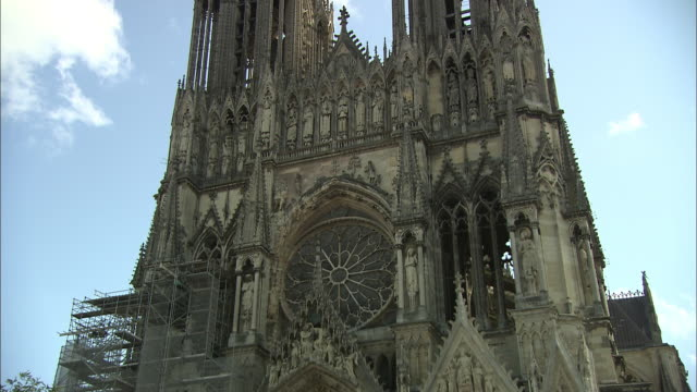 construction scaffolding is seen on the exterior of the notre-dame de reims. - notre dame de paris stock videos and b-roll footage