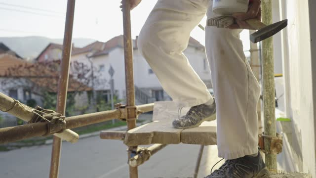 construction senior worker on scaffolding - scaffolding stock videos & royalty-free footage