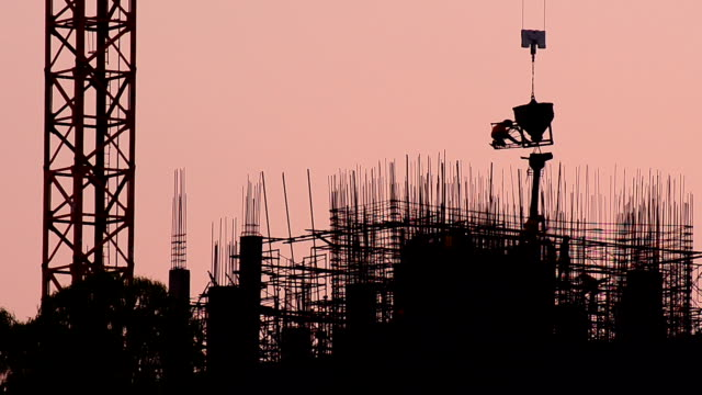 construction silhouette at sunset - crane construction machinery stock videos & royalty-free footage