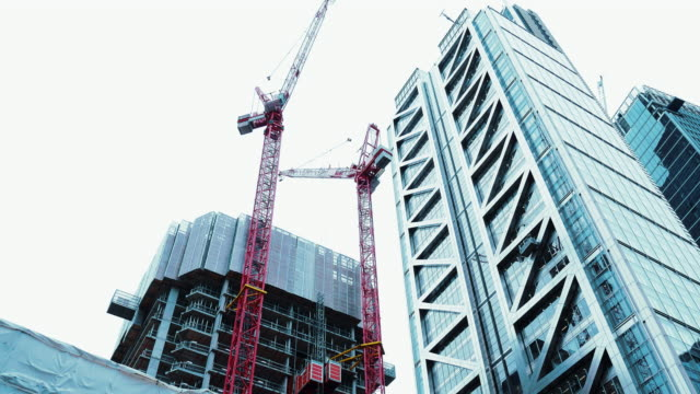 construction site and modern corporate building in london, uk - construction industry stock videos & royalty-free footage