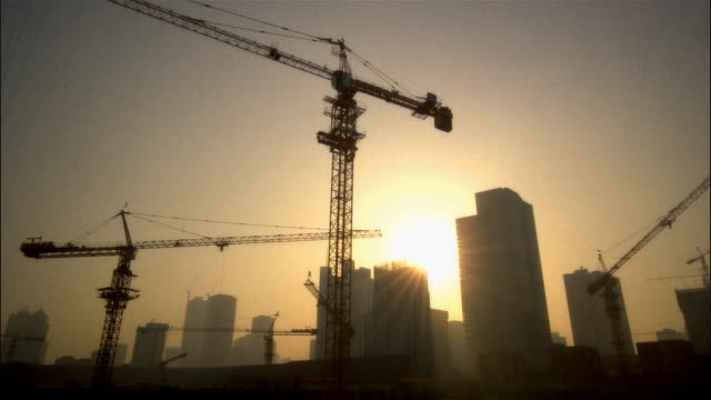 MS, LA, Construction site at sunset, Beijing, China