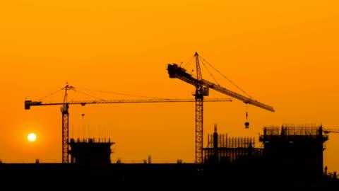 construction site at sunset - silhuett bildbanksvideor och videomaterial från bakom kulisserna