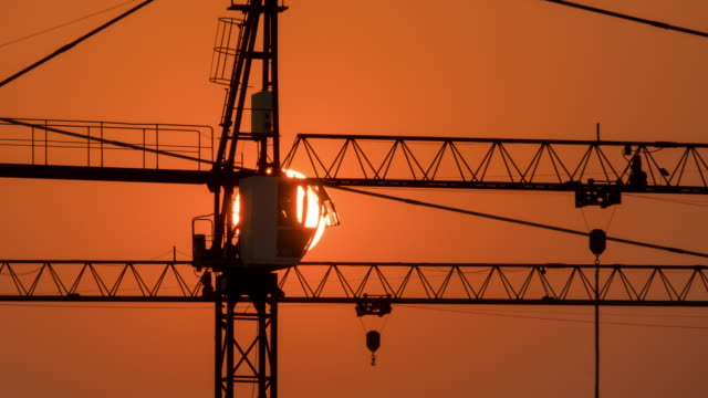 construction site at sunset - scaffolding stock videos & royalty-free footage