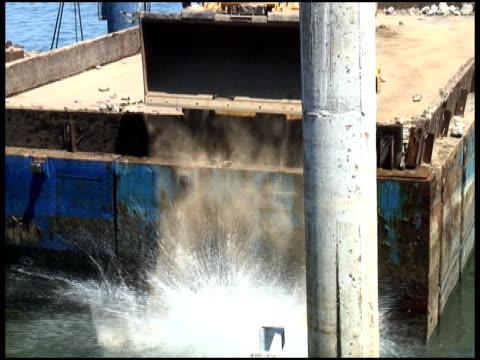 construction site: dumping rocks into water - letterbox format bildbanksvideor och videomaterial från bakom kulisserna