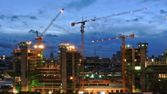 construction site from dusk to night time lapse - scaffolding stock videos & royalty-free footage