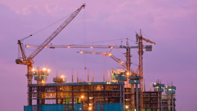 construction site from dusk to night time lapse - construction site stock videos & royalty-free footage