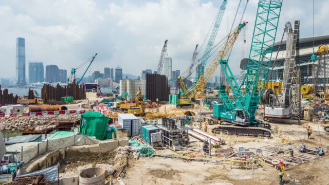 t/l ws pan construction site / hong kong, china - baugewerbe stock-videos und b-roll-filmmaterial