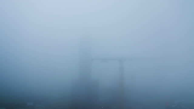 construction site in extremely thick fog - construction site stock videos & royalty-free footage