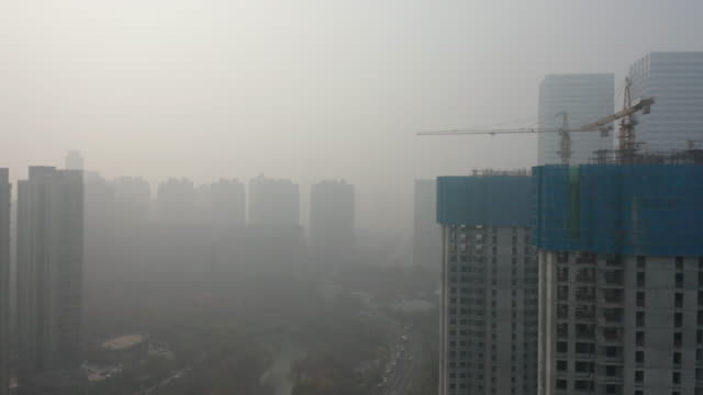 construction site in foggy city - overcast stock videos & royalty-free footage