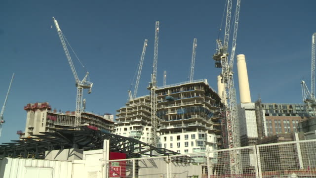 construction site in london that has downed tools during the coronavirus lockdown and has furloughed workers using the government's job retention... - construction site stock videos & royalty-free footage