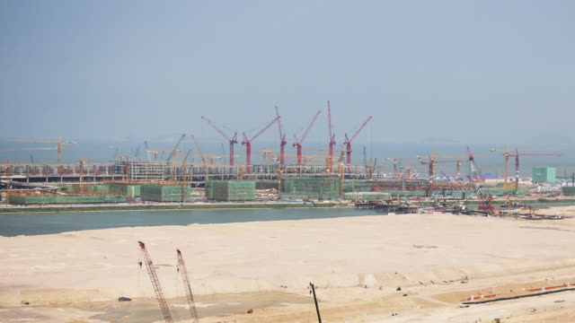 construction site on man made islands time lapse - macao stock videos & royalty-free footage