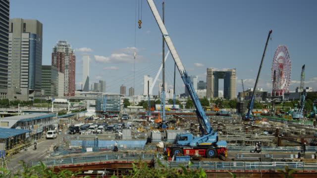 ws construction site opposite television building / tokyo, tokyo-to, japan   - 放送点の映像素材/bロール