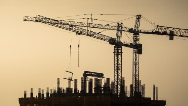 Construction Site Silhouettes at Dusk - Time Lapse