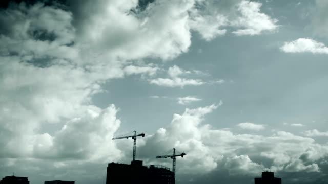 T/L Construction site skyline with dynamic cloudscape