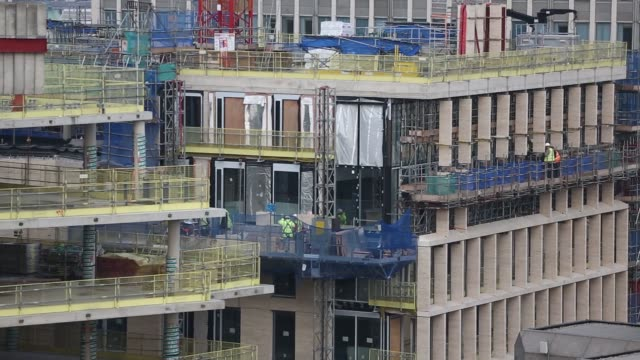 a construction site stands backdropped by the skyline of westminster london on thursday 30th october gvs of construction workers skyline of victoria... - victoria tower stock-videos und b-roll-filmmaterial