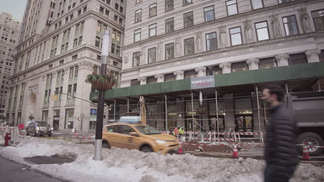 construction site with construction workers drilling into the ground on broadway in lower manhattan new york city with yellow taxi driving by. filmed... - yellow taxi stock videos & royalty-free footage