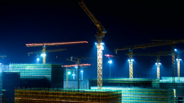 construction site with cranes at night - crane stock videos and b-roll footage