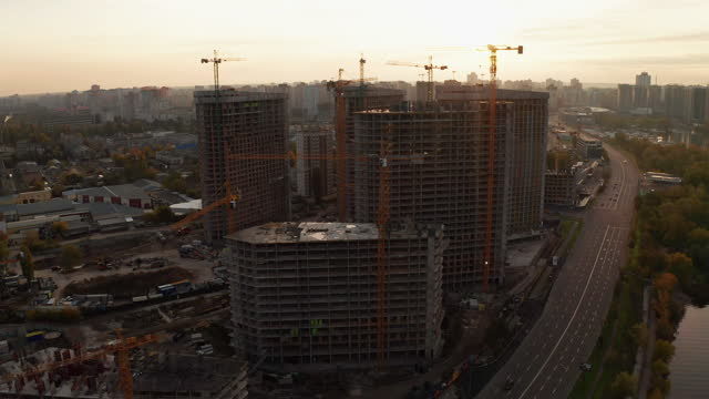 construction site with cranes at sunset. construction of an apartment building - ukraine stock videos & royalty-free footage