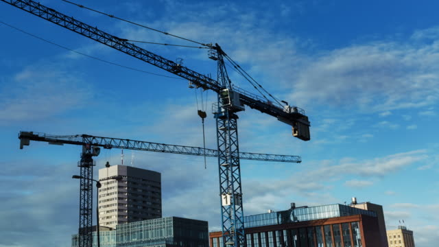 construction site with cranes. big city panorama with skyscrapers - high up stock videos & royalty-free footage