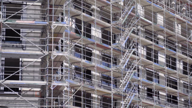 construction site with scaffolding of a new office building in berlin, germany. - scaffolding stock videos & royalty-free footage