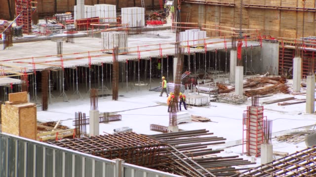 construction site workers timelapse - concrete stock videos & royalty-free footage
